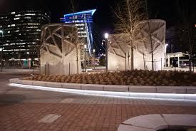 the plexineon fixtures were bent in the field to outline the sculptural teardrop shape of the bench lighting