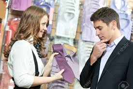man and assistant at apparel clothes shopping stock photo picture stock photo man and assistant at apparel clothes shopping