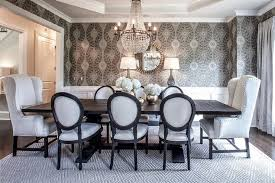 black and white dining table set: elegant dining table features an octagon tray ceiling accented with a clear beaded chandelier illuminating a black salvaged wood dining table