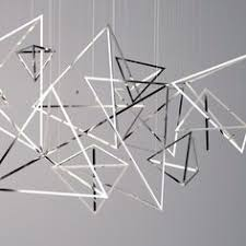 bangle bangle is a precise assembly of scattered pyramidal forms discretely suspended lighting within lighting design images