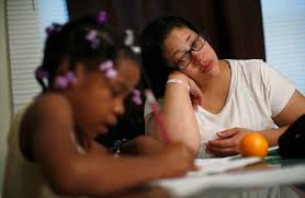 mental depletion complicates financial decisions for the poor delores leonard r helps her daughter erin her homework at the breakfast table