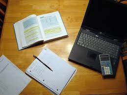 How to Get Children to Do Their Homework Exam Papers Plus Desk with laptop  calculator  notepad and books