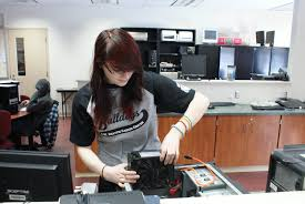 a w beattie career center a computer systems technology student replaces a power supply in a pc