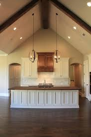 vaulted ceiling wood counter top island in kitchen parade of homes 2014 ceiling light sloped lighting