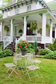 old victorian style house with rustic antique recycled garden patio furniture pots in containers apothecary style furniture patio