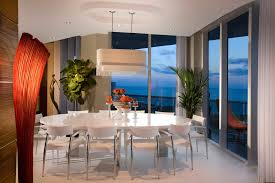 modern dining room example of a minimalist dining room design in miami with beige walls b131t modern noble lacquer dining table