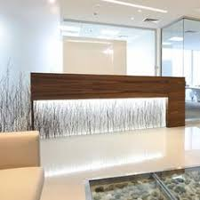 glowing varia birch grove reception desk and feature wall this desk was constructed in an office building in dubai might be a nice idea for your modern office reception desk