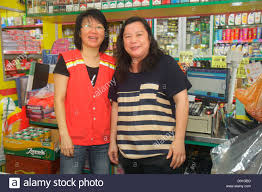 singapore jalan besar convenience store worker employee job singapore jalan besar convenience store worker employee job cashier coworkers asian w