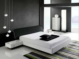 stylish white low profile platform bed with black headboard and black painted walls and white gloss black and white bedroom furniture