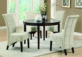 dining table parson chairs interior: vintage french fabric parson chairs with round table and rug for dining room decoration ideas