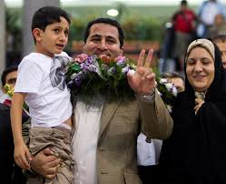 a hero or u s spy nuke scientist claimed innocence before ian scientist shahram amiri flashes the victory sign as he arrives at the imam khomini airport