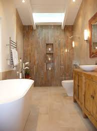 skylight brings ample natural light into the bathroom design oberhauser interiors ample shower lighting