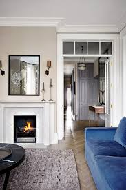 a small grey and white living room with blue sofa in living room design ideas blue couch living room ideas
