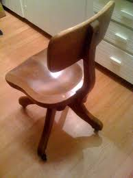 i am thinking about refinishing this chair but will sell it as is its a beautiful swiveling chair with metal casters there is a small sticker on the antique wood office chair