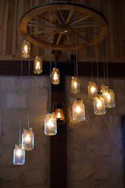 spiral wagon wheel mason jar chandelier large alternating length wagon wheel mason jar