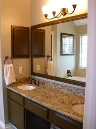 alluring desaign bathroom mirror ideas under small pednant lamp on calm wall paint captivating bathroom vanity twin sink enlightened