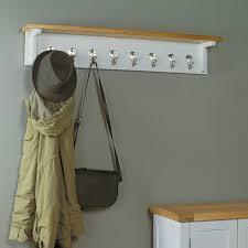 chadwick satin lacquered oak wall shelf with hooks coat rack baumhaus space baumhaus mobel solid oak medium wall mirror
