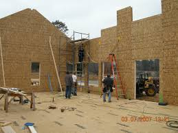 Structural Insulated Panels  SIPs    Building America Solution CenterWalls are being assembled at this SIP house