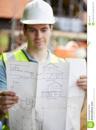 Construction Worker On Building Site Looking At House Plans Stock    Construction Worker On Building Site Looking At House Plans