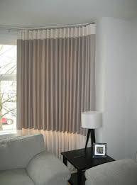 contemporary wave linen curtains fitted in a bay window with a top and bottom contrast