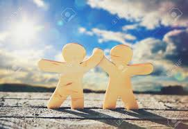 cooperation stock photos images royalty cooperation images cooperation wooden little men holding hands on sky and sun background symbol of friendship