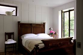 bedroom paneling ideas: wall paneling ideas for rustic bedroom with dark wood headboard