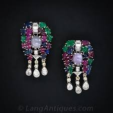 This pair of fabulous and festive Art Deco earrings are composed of ...