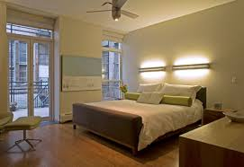 apartment cozy bedroom design: apartmentcozy small bedroom with storage bed frame fits with white bedding on wooden flooring