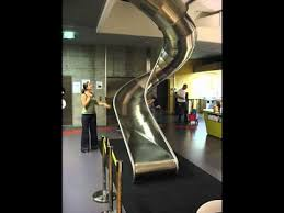 google zrich office slide to the canteen youtube amazing google office zurich