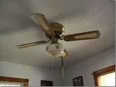 dont throw away that ugly ceiling fan paint it seems totally do ceiling fans ugly