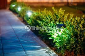 solar garden light lanterns in flower bed garden design stock photo area lighting flower bed
