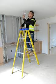 stepping up the youngman ladder professional electrician working at height requires its own set of measures and when you add electricity into the mix you need to be sure you are using equipment that can offer you