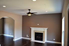 taupe accent wall family room traditional remodeling ideas with ceiling fan custom fireplace surroun accent lighting family room
