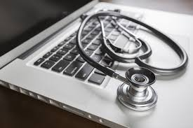 improving your healthcare resume fusion healthcare staffing medical stethoscope resting on laptop computer keyboard
