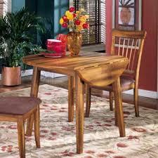 ashley furniture kitchen tables: ashley furniture berringer round drop leaf table
