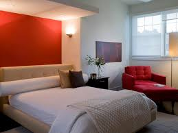 red wall paint black bed: bedroom red wall paint color red sleeper sofa dark brown wooden drawers light brown soft bed frame white blanket decorative plants wall lighting floor