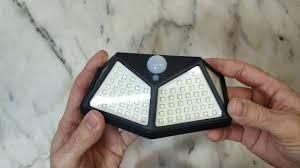 <b>100 LED Solar</b> Powered <b>PIR</b> Motion Sensor Wall Light <b>Outdoor</b> ...