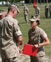 female marines in the media 59 the semi normal day to day 1stlt tabitha pinter the company commander for transportation support company combat logistics battalion 8 receives the navy and marine corps achievement
