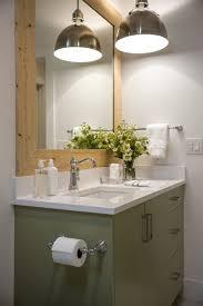 simple grey nuance interior bathroom with warm bathroom lighting hanging with black cabinet brings elegant touch inside modern bathroom of elegant house bathroom light fixtures ideas hanging