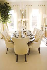 chair dining tables room contemporary: bright sunny dining room with oval wood table and eight plush cream colored dining chairs