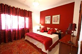 red wall paint black bed: bedroomagreeable romantic couple red bedroom decor ideas with black bed frame also cream window