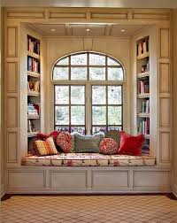 something similar but move the bookshelves on to the walls flanking the window so you bay window seat