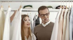 man talking s assistant in clothes shop royalty s assistant