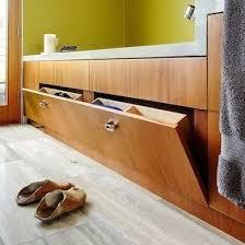 bathroom space savers bathtub storage: bathtub storage a shallow tilt out drawer on the side of the bathtub