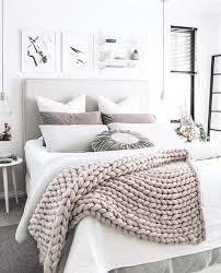 a chunky knit wool throw adds texture and interest to a gray and white bedroom bedroom white
