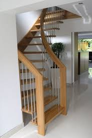 design ideas small spaces image details: alluring design ideas of small space staircase with brown wooden treads and handrails also stainless steel