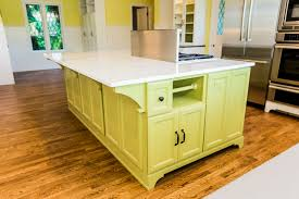 calacatta marble kitchen waterfall: calcutta marble kitchen island with range envision interiors