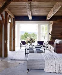 room french style furniture bensof modern: a modern farmhouse in upstate new york french doors open from the living room to the terrace the sergio rodrigues leather armchairs are from espasso