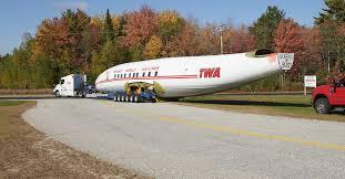 <b>Vintage</b> TWA <b>airplane</b>, set to become <b>retro</b> cocktail lounge, arrives at ...