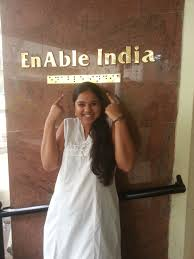 hearing impaired enable picture of kavya standing in front of main office